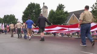 Large American flag carried in 4th of July parade 4k