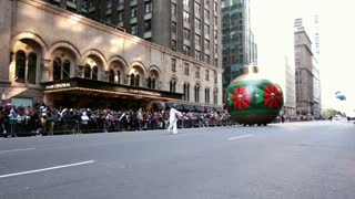 Large Christmas Ornament driving in Macy's Parade