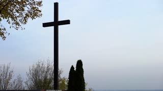 Large cross with dark gray sky in the background 4k
