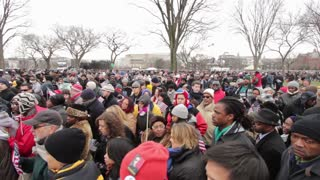 Large crowd of people exiting inauguration 2013