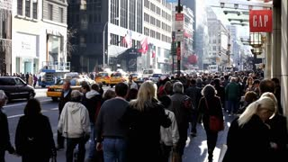 Large crowd of people on New York City sidewalk