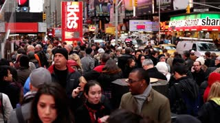 Large crowd of people standing in Times Square