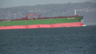 Large Green Ship in Ocean
