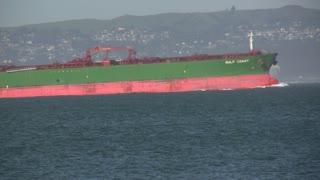 Large Green Ship in Ocean