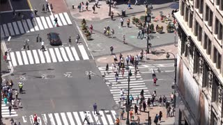 Large group of pedestrians and New York City traffic on street 4k