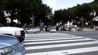 Large group of people crossing at sidewalk