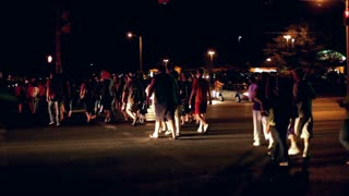 Large Group of people crossing street at night