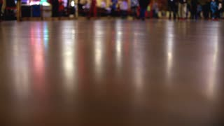Large group of People skating by at Roller Rink