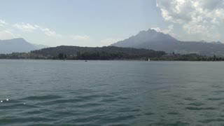 Large Mountain in Switzerland seen from water