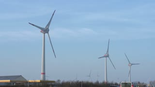 Large windmill off German highway spinning