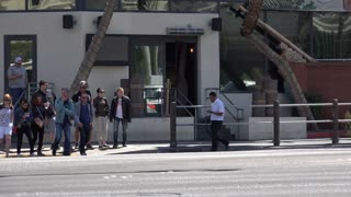 Las Vegas Boulevard with pedestrians crossing street 4k