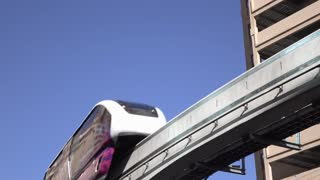 Las Vegas monorail with graphics on side going by 4k
