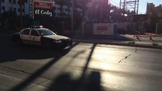 Las Vegas police car drives by in Fremont District.