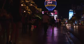 Las Vegas sidewalk to Eiffel Tower tilt at night 4k.