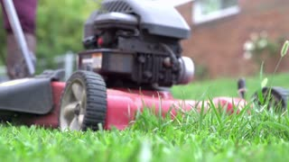 Lawn mower grass shooting out in slow motion