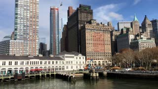 Leaving New York City on boat with view of buildings 4k