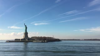 Liberty Island seen from boat tour coming from NYC 4k