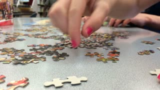 Library puzzle building with kids.