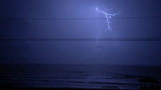 Lightning strikes over ocean slow motion 720p