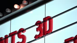 Lights flashing on movie theater marquee for 3D film 4k