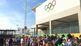 Line of spectators waiting to enter Olympic Park on opening day Rio 2016 4k