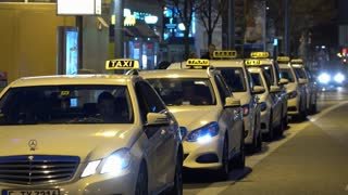 Line of Taxi drivers waiting for late night crowd in Frankfurt Germany 4k