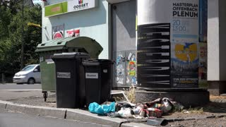 Litter in Frankfurt Germany around trash dumpster 4k