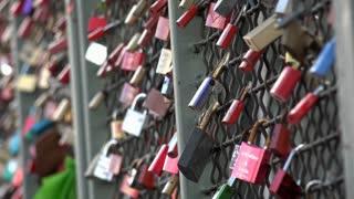 Locks of love hanging on fence 4k