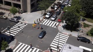 Looking down at city intersection with construction crew 4k