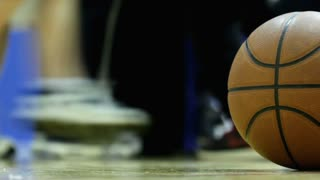 Low view of Basketball sitting on Court
