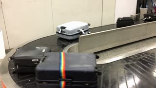Luggage at airport on conveyor belt