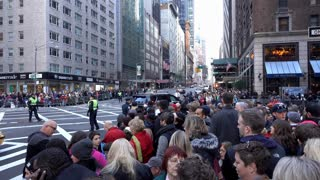 Macys Thanksgiving Parade route with people waiting on sidewalk 4k