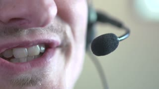 Male customer service agent talking on headset