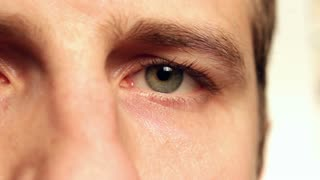 Male face focus on eye