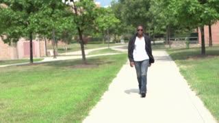 Male model walking on sidewalk