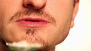 Male mouth eating cereal close up