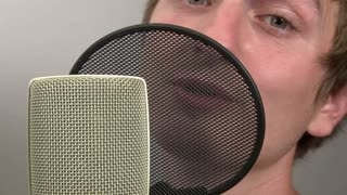 Male Singing into Microphone