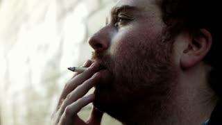 Male smoking cigarette color corrected