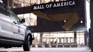 Mall of America entrance with Police Vehicle parked in snow 4k