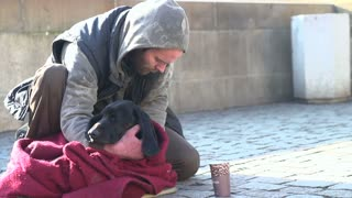 Man and dog sitting on streets of Prague slow motion part 1