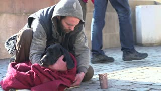 Man and dog sitting on streets of Prague slow motion part 2