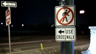 Man at Night crossing at Crosswalk