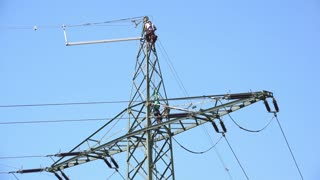 Man climbing down electrical power line 4k