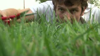 Man Cutting Lawn with Scissors gets Angry