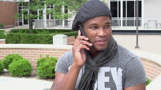 Man finishes cell phone conversation