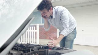 Man getting very upset at broken car