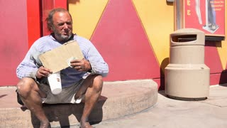 Man holding blank sign needing help in Las Vegas 4k