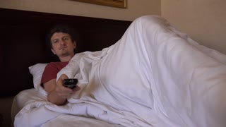Man in hotel bed turns off Tv and goes back to sleep 4k