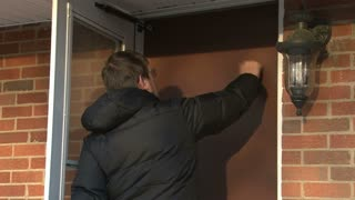 Man Knocking on House Door