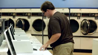 Man loading clothes into washer